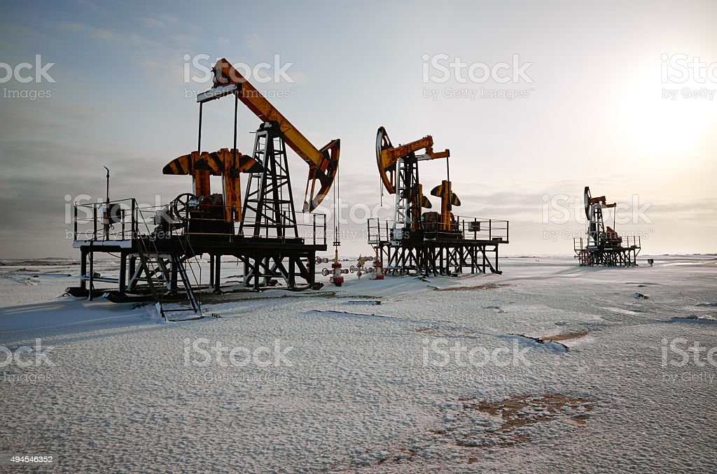 Oil rig back sun light stock photo