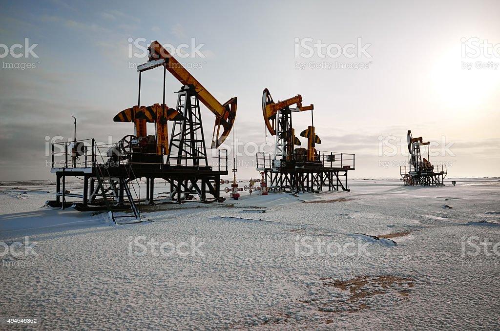 Oil rig back sun light stock photo