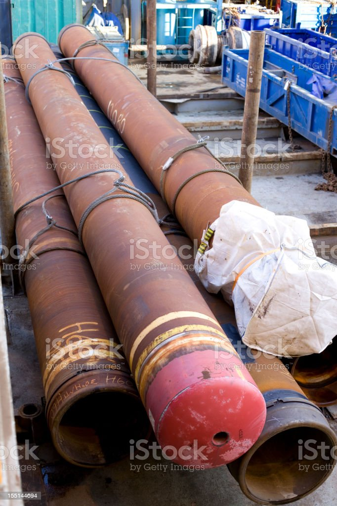 oil rig casing pipe on deck royalty-free stock photo