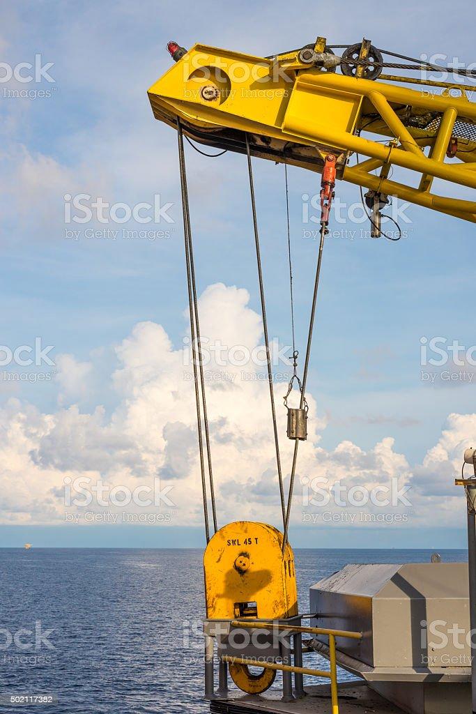 Oil rig crane hoist at storage stock photo
