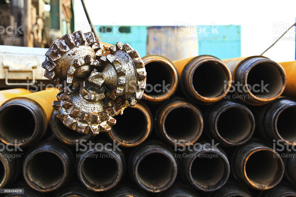 oil rig drill bit with drilling pipe stock photo
