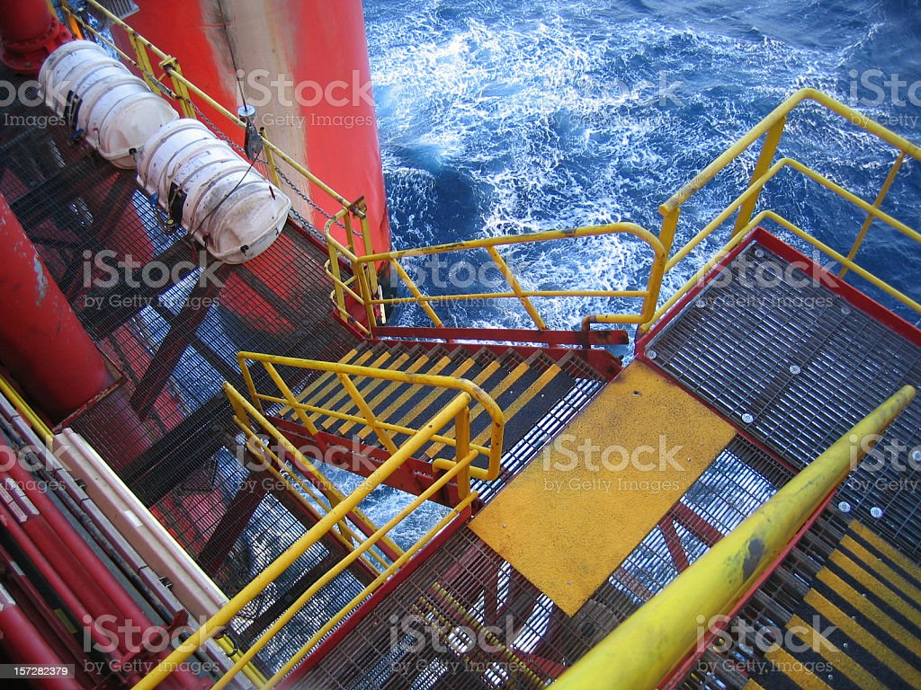 oil rig escape ladder and liferaft royalty-free stock photo