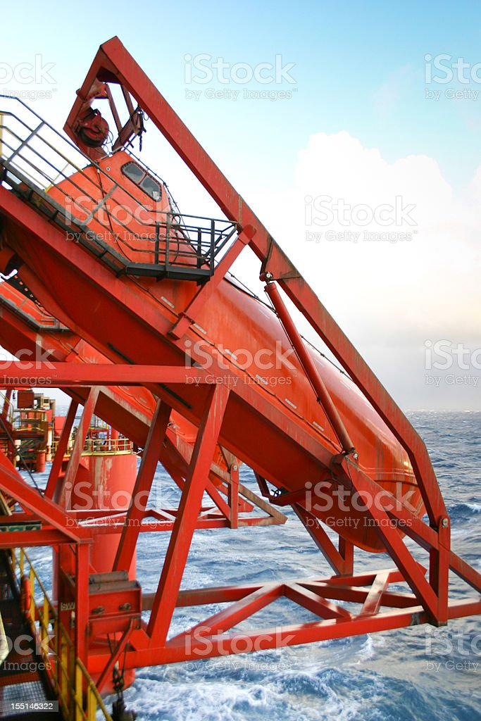 oil rig escape lifeboat royalty-free stock photo