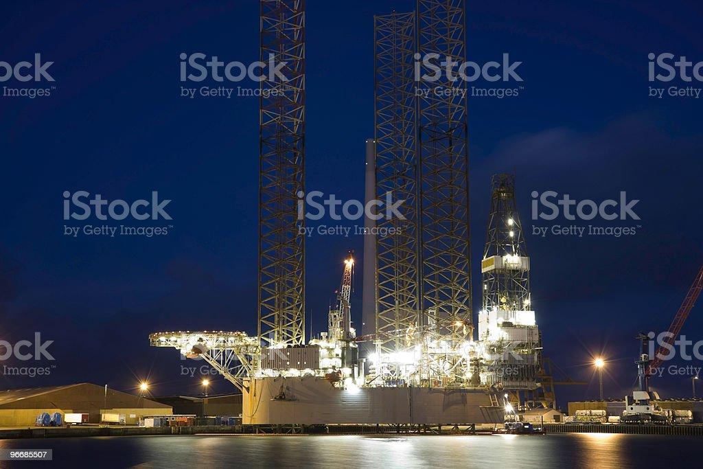 Oil rig in harbor stock photo