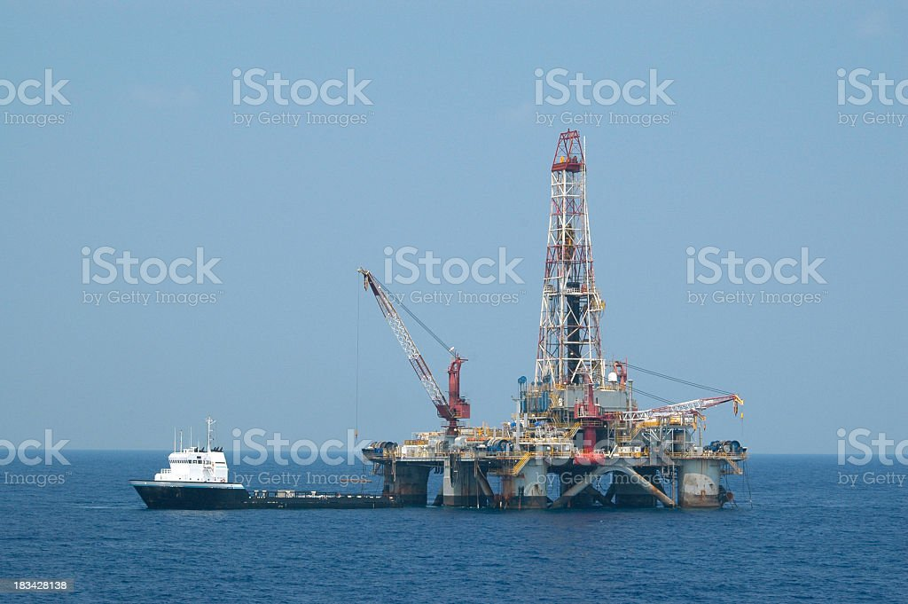 Oil rig loading on pipe from supply vessel stock photo