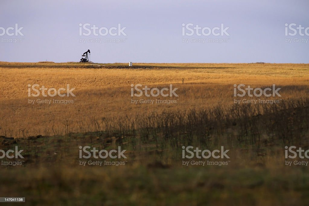 Oil rig on prairie horizon royalty-free stock photo