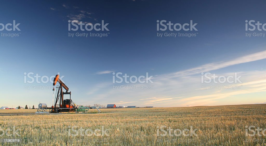 Oil Rig on the Plains in the Midwest stock photo