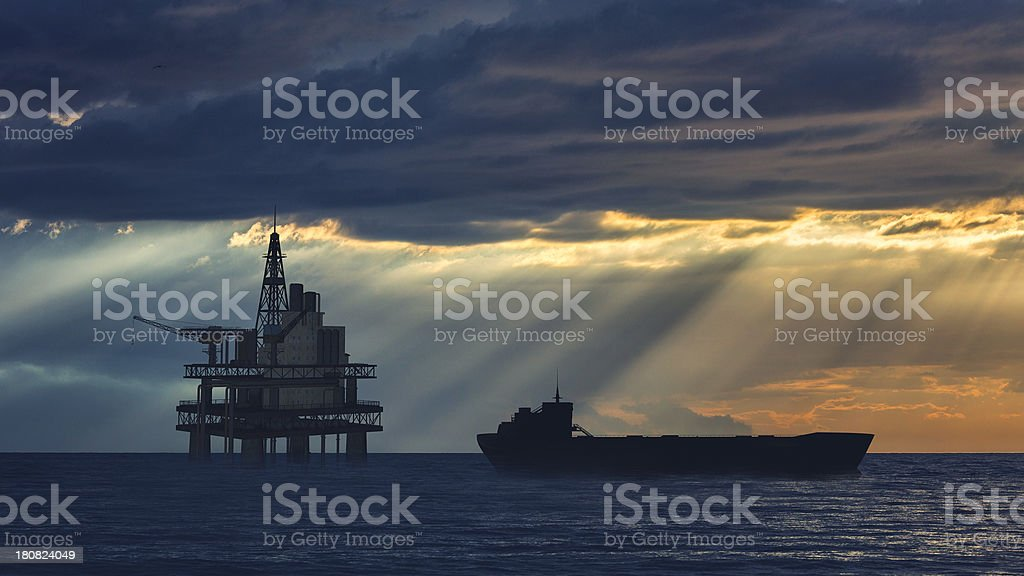 Oil rig on the sea with approaching tanker ship stock photo