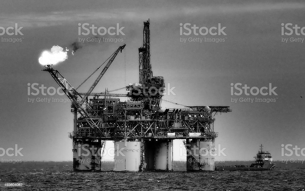 oil rig or platform flaring, offshore petroleum industry stock photo