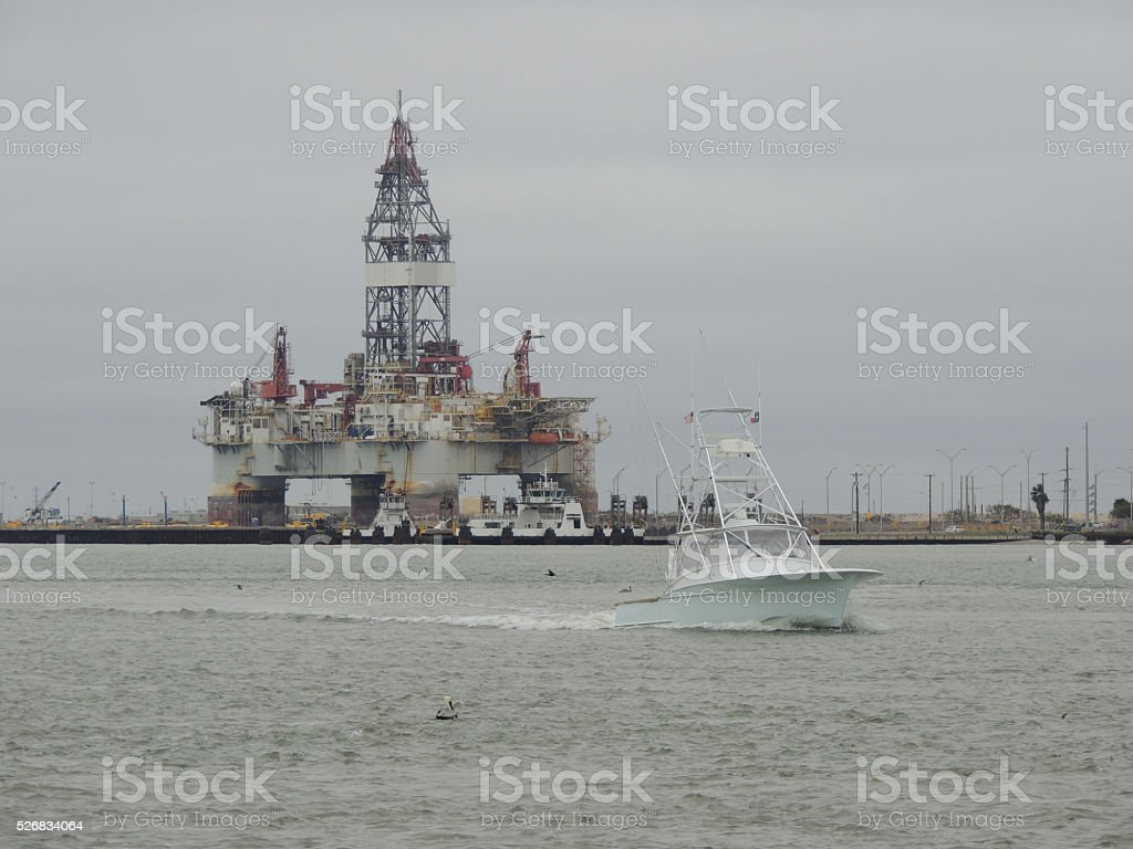 Oil Rig or Platform with a boat going past stock photo