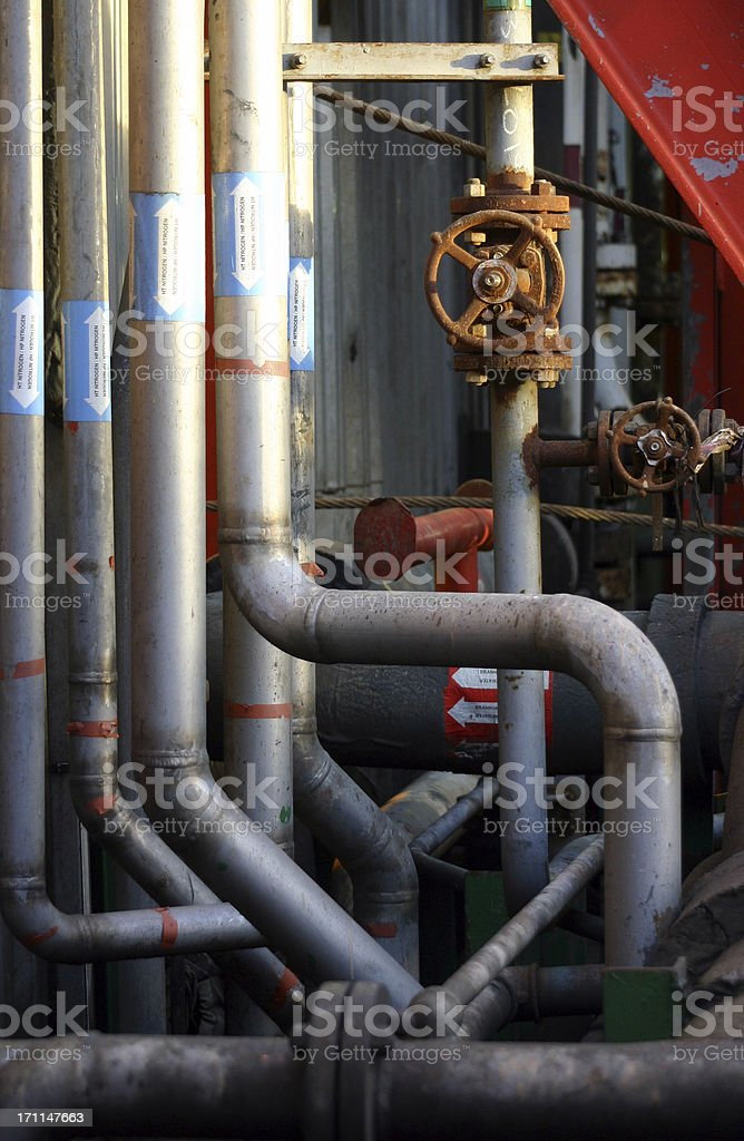 oil rig pipes and valves stock photo