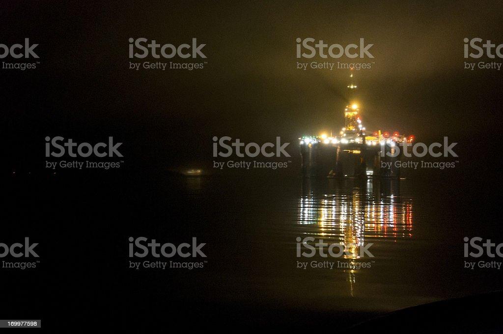 oil rig platform at sea nightime royalty-free stock photo