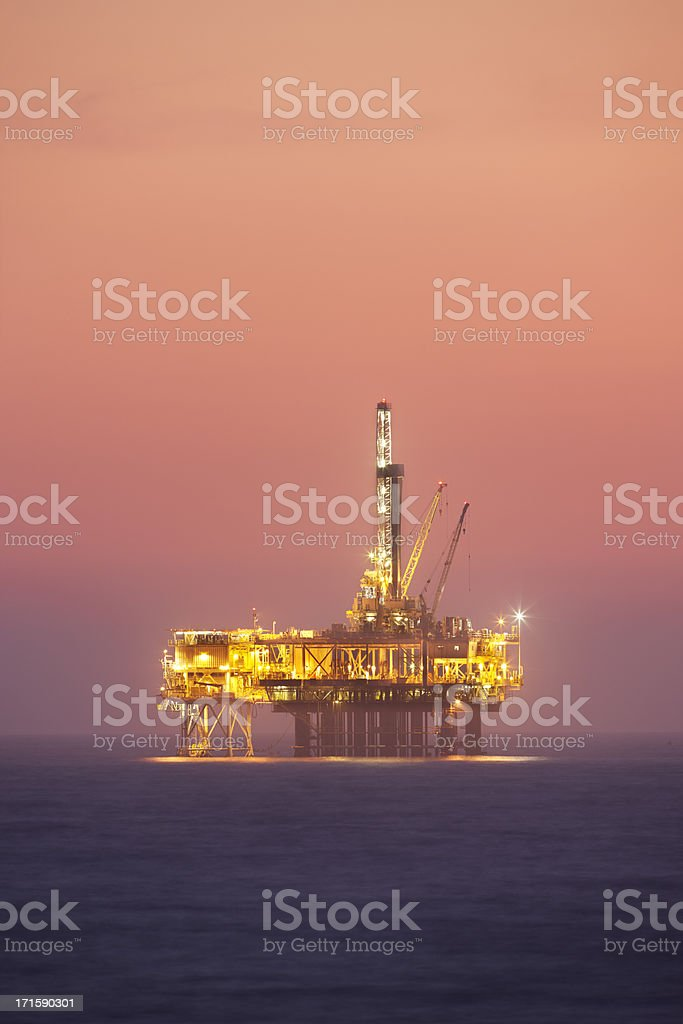 Oil rig platform in twilight. royalty-free stock photo