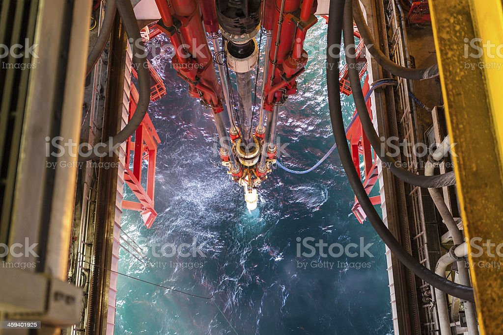 oil rig platform riser pipes to sea stock photo
