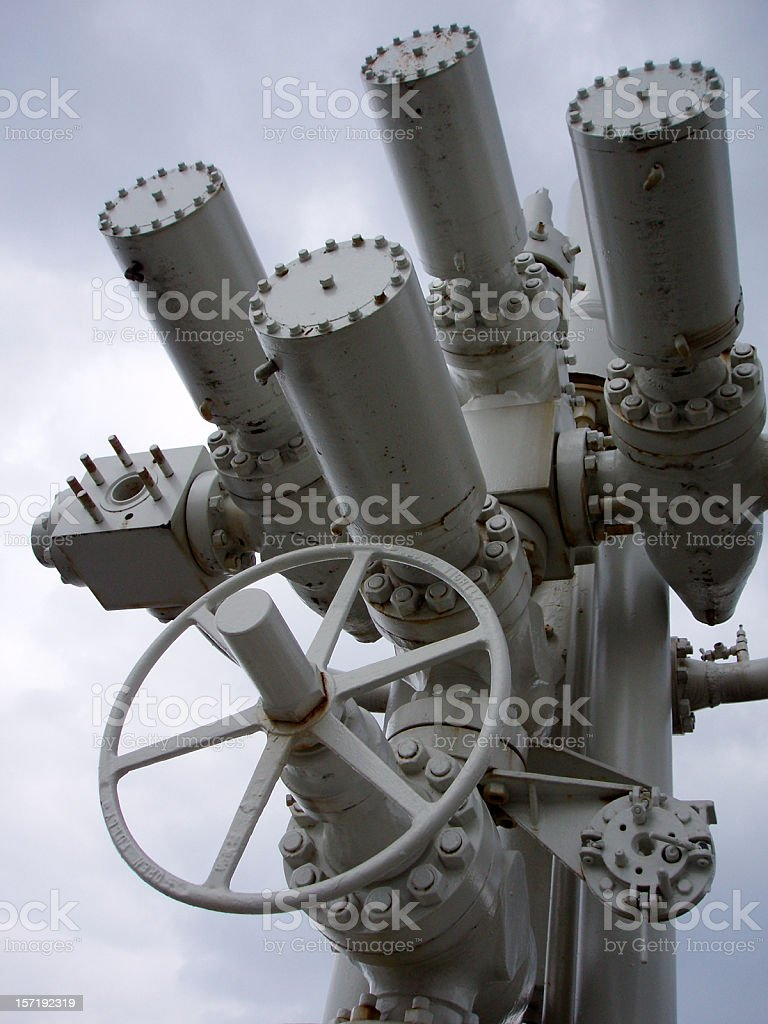 oil rig platform wellhead valves and wheel royalty-free stock photo
