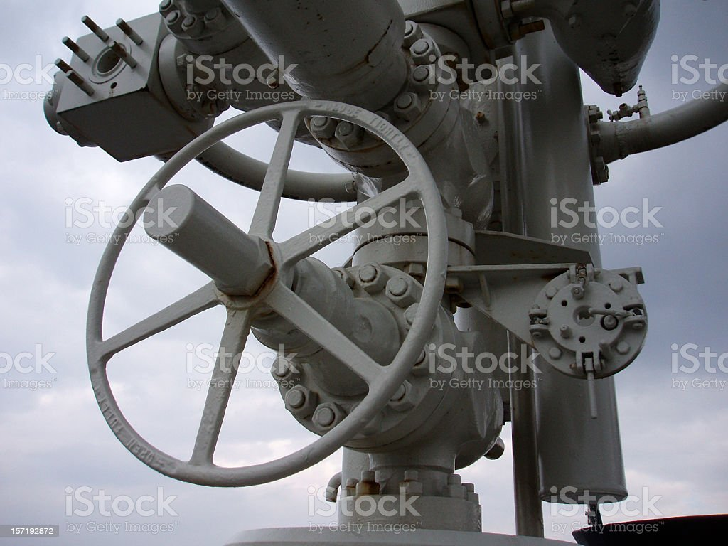 oil rig platform wellhead valves and wheel royalty-free stock photo