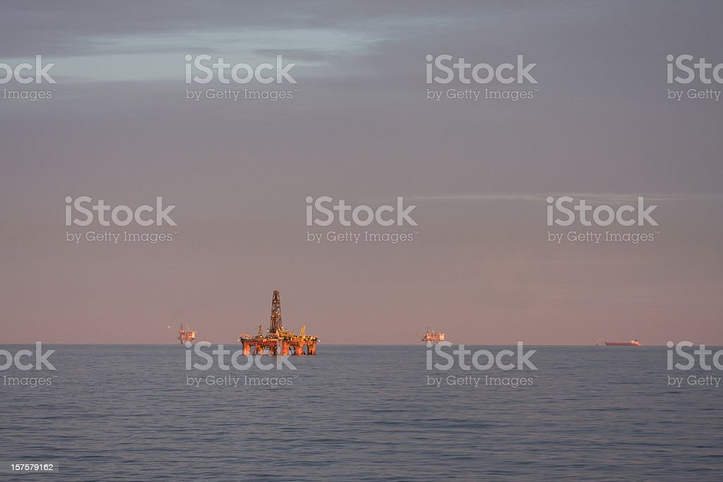 oil rig platforms at sea royalty-free stock photo