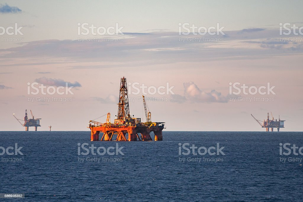 oil rig production platforms at sea stock photo