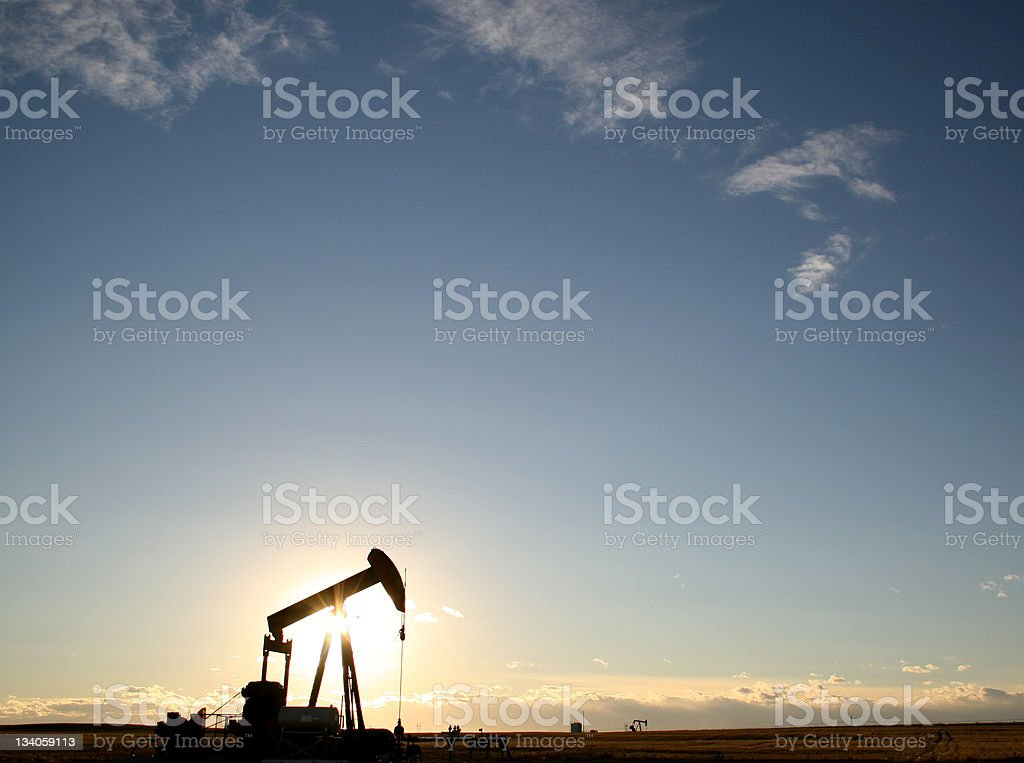 Oil Rig Pumpjack on the Canadian Prairie stock photo