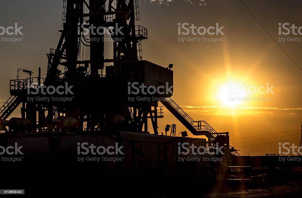 oil rig shilouette stock photo