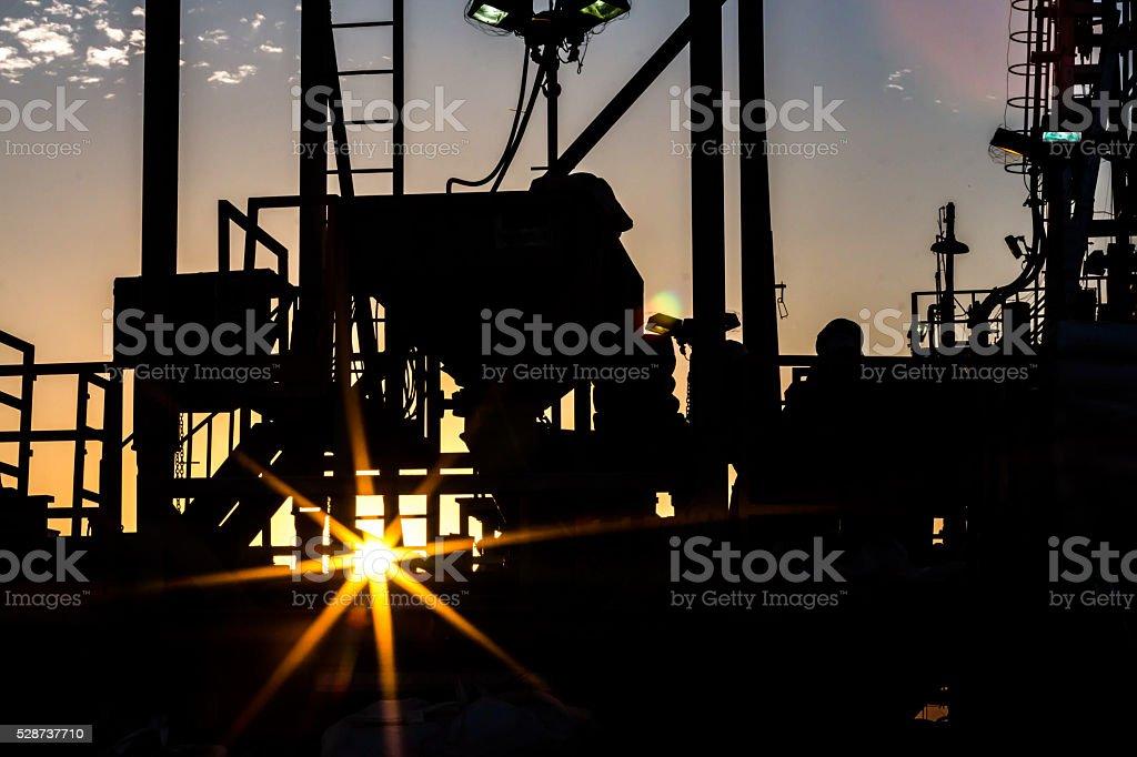 Oil rig silhouette stock photo