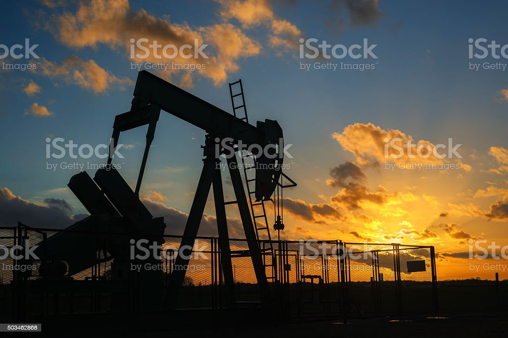 oil rig silhouette pumping royalty-free stock photo