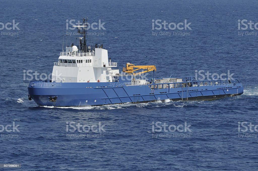 Oil Rig Supply Vessel On Blue Water stock photo