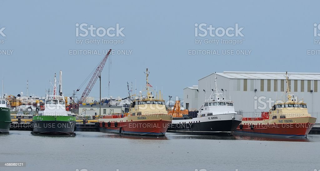 Oil rig supply vessels in port stock photo