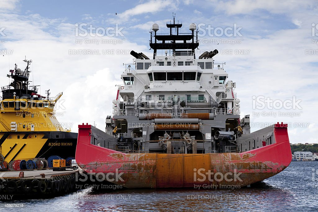 oil rig support boats in dock royalty-free stock photo