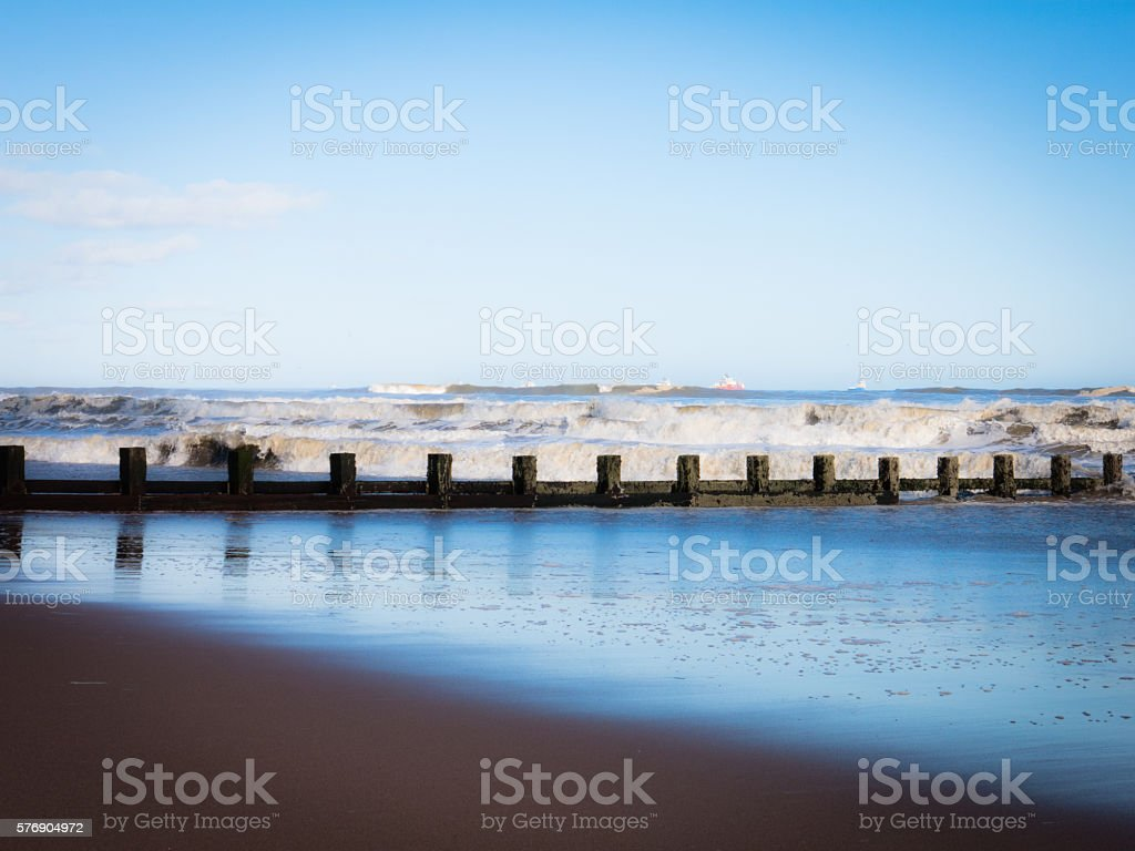 Oil Rig Support Vessel Beach Reflections stock photo