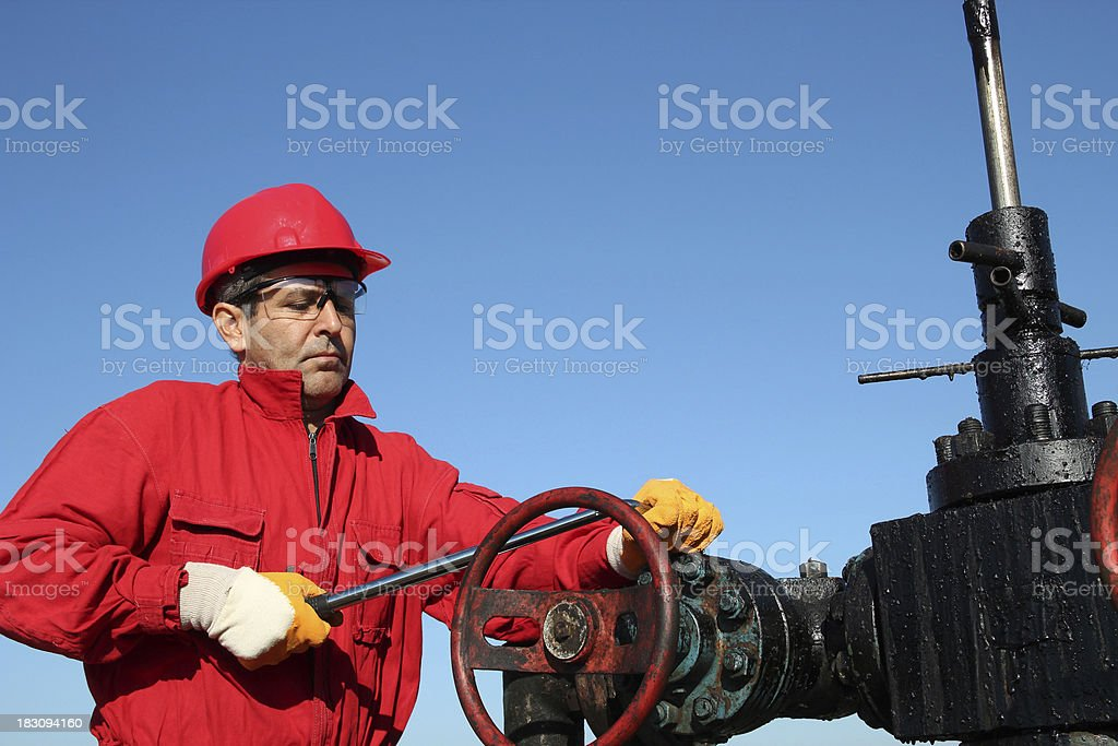 Oil Rig Valve Technician at Work royalty-free stock photo