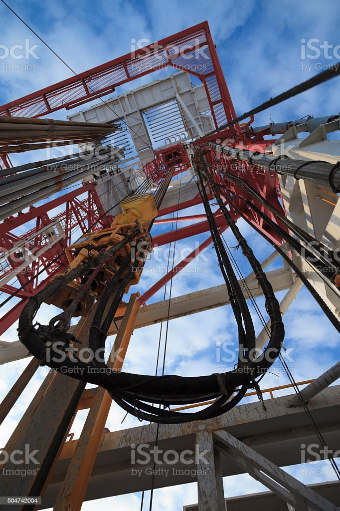 Oil rig view from bottom to top with blue sky stock photo