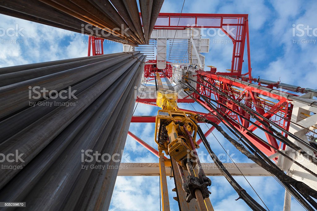 Oil rig with Pipes from bottom to top view stock photo