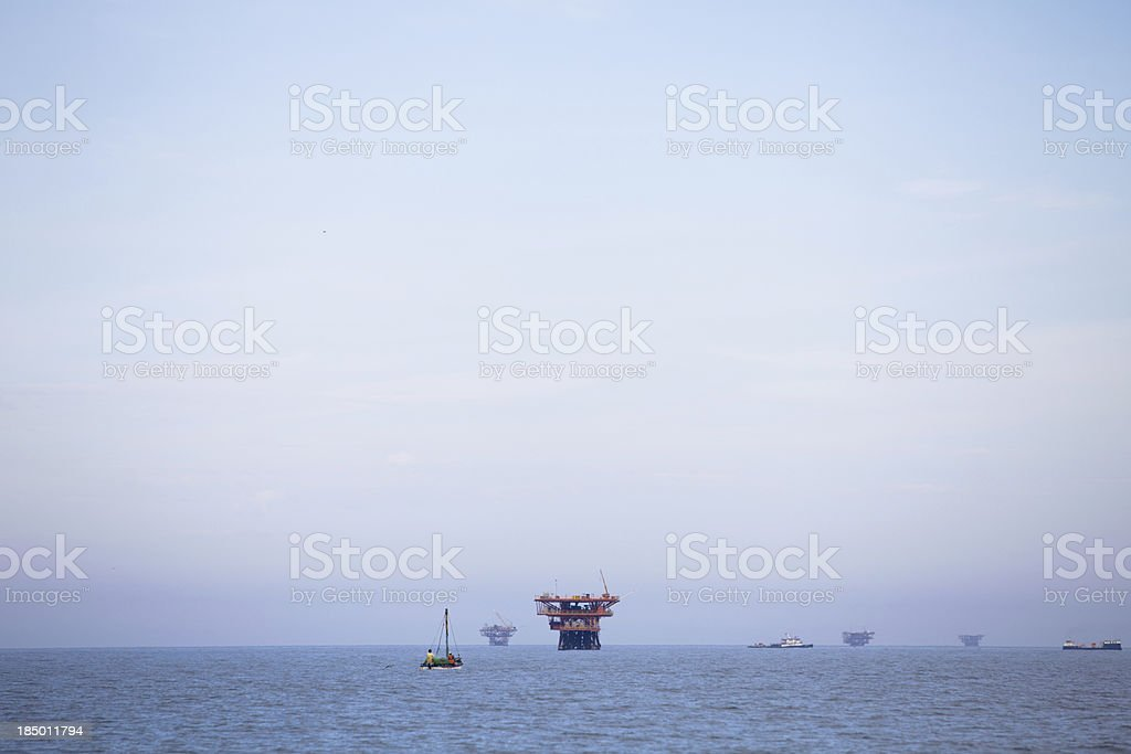 Oil Rigs and boats royalty-free stock photo
