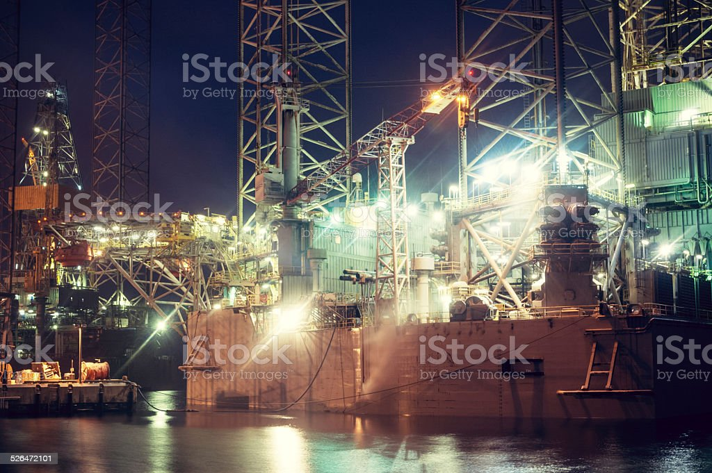 Oil Rigs at Night stock photo
