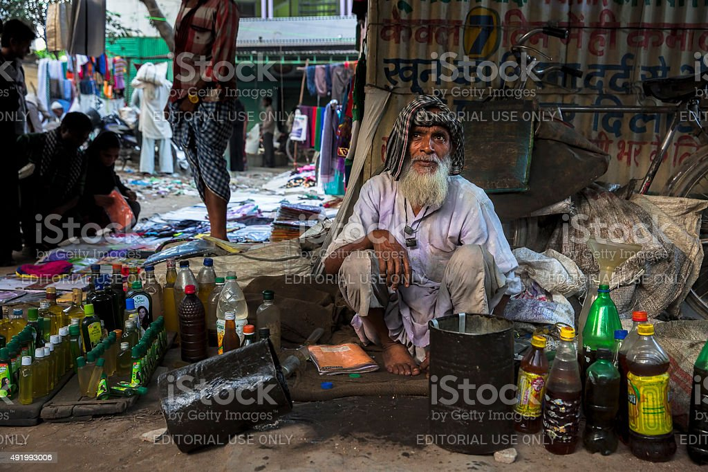 Oil seller waiting for customers stock photo