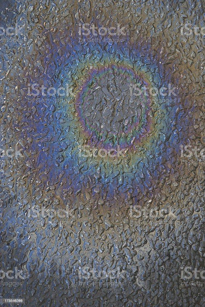 Oil Slick Rainbow on Black Asphalt stock photo
