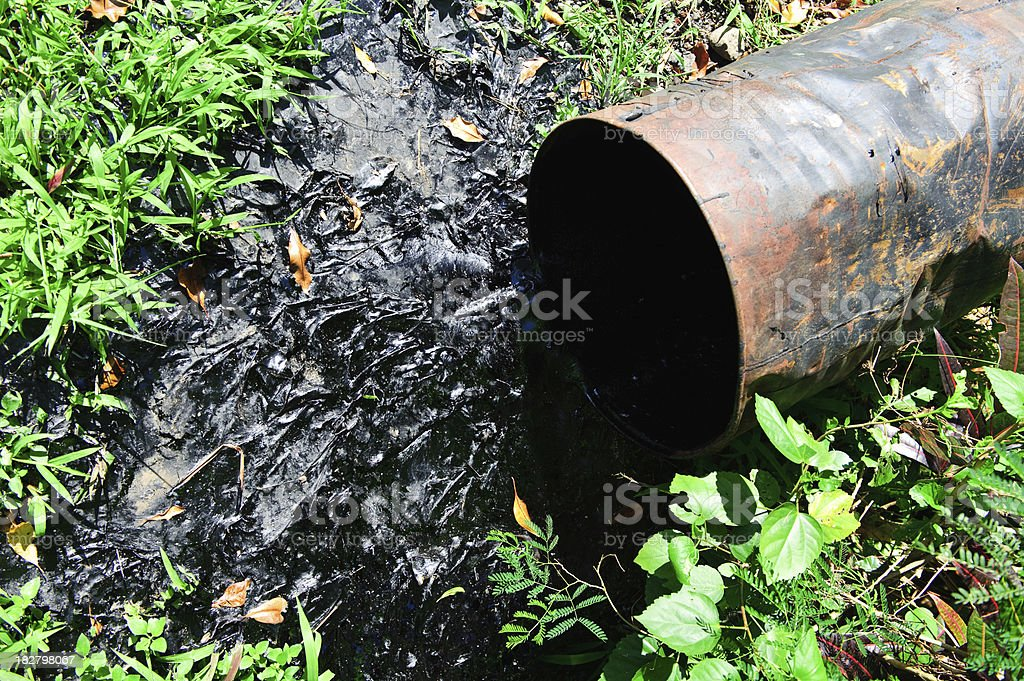 Oil spill drum pollution environmental disaster stock photo