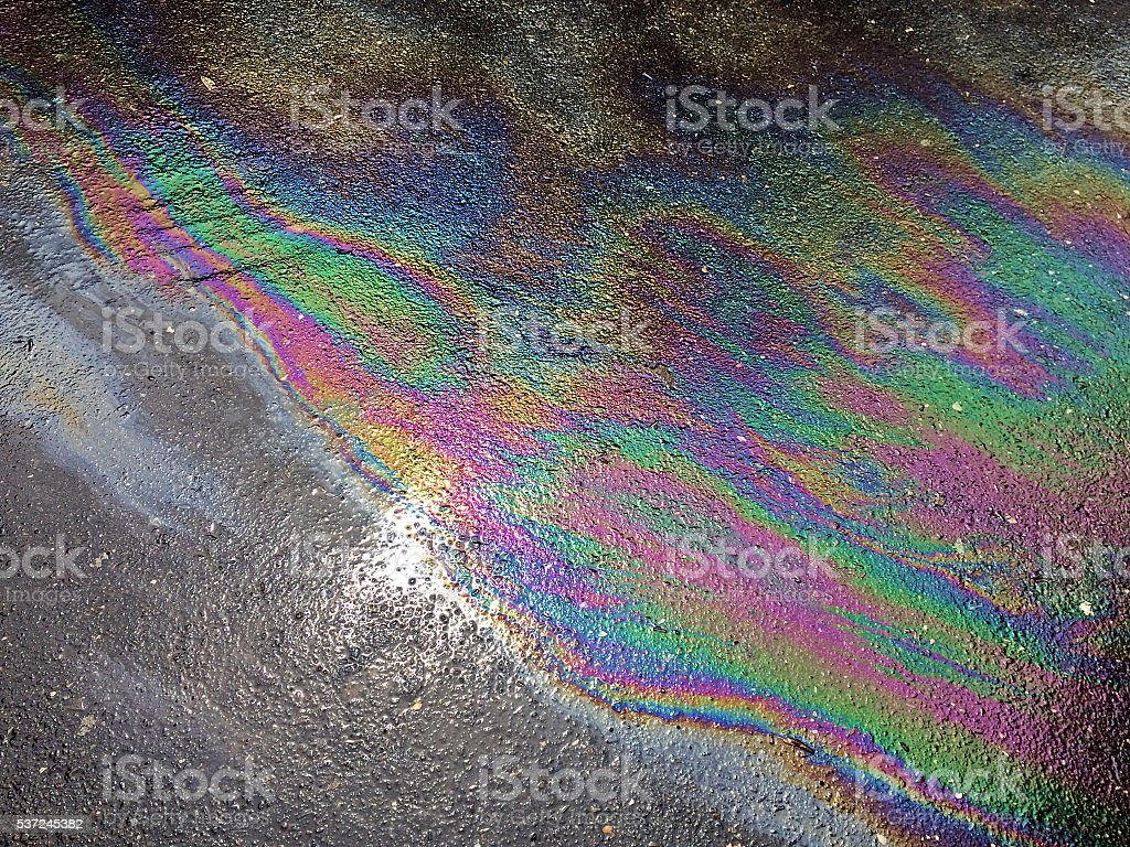 Oil spill on asphalt stock photo