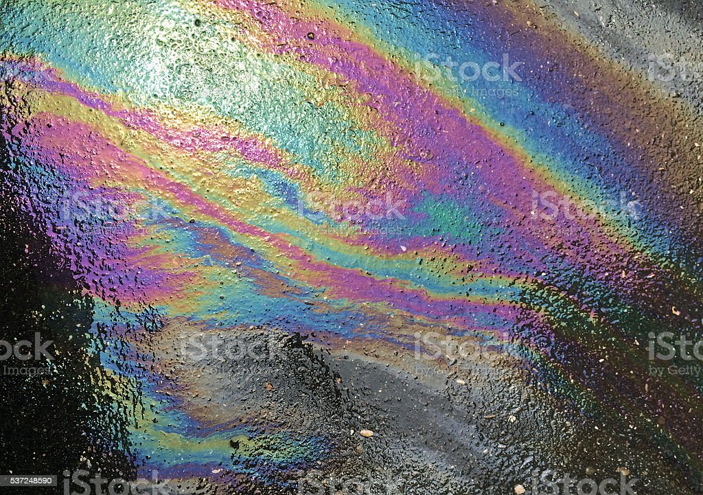 Oil spill on asphalt stock photo