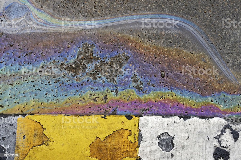 Oil spill on asphalt road background or texture stock photo