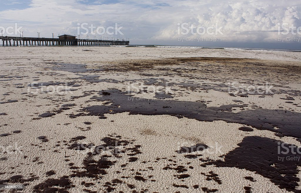 Oil spill on beach in Alabama royalty-free stock photo