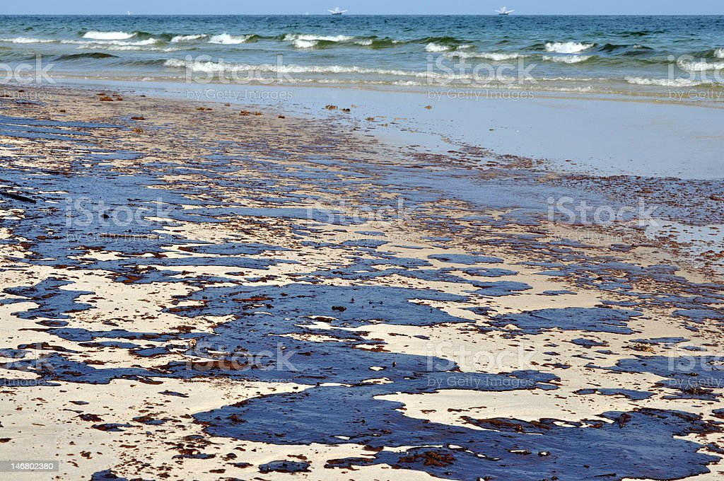Oil Spill on Beach stock photo