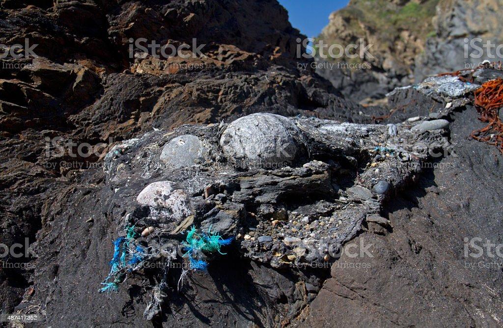 Oil spill on coast stock photo
