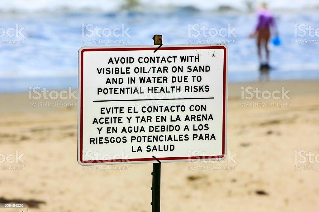 Oil Spill warning sign on Arroyo beach Santa Barbara stock photo