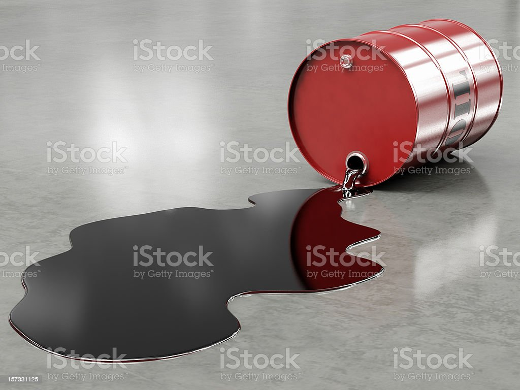Oil spilling from red barrel onto floor stock photo