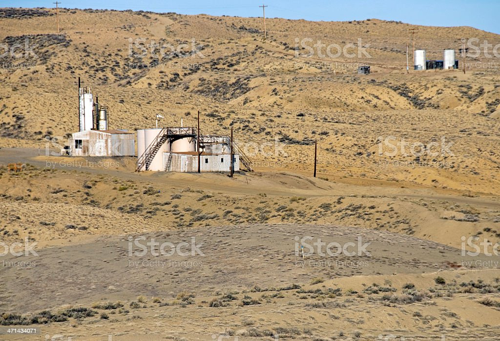 Oil storage tanks and buildings in southern Wyoming royalty-free stock photo
