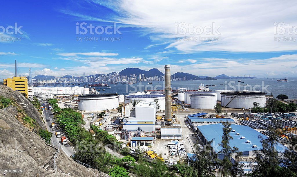 Oil Storage tanks with urban background stock photo