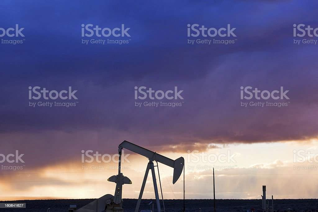 oil sunset silhouette stock photo