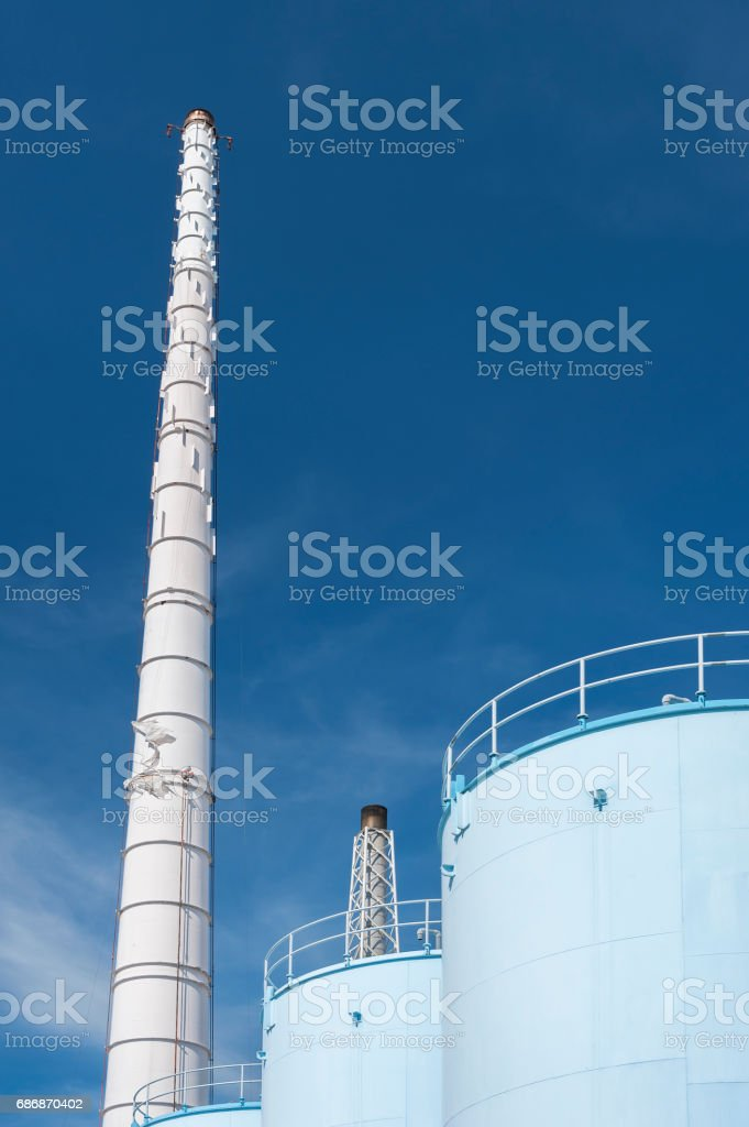 Oil tank and chimney stock photo